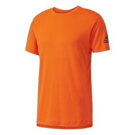 ADIDAS BK6090 FREELIFT PRIME TRIČKO PÁNSKE oranžové  ADIDAS